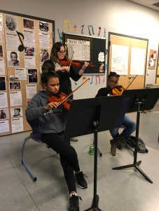 Mallory Lorde Jirout, 11, violin. (on the left next to teacher Lindsay Fredrickson and student Kyleigh Jackson, right) Why do you like orchestra? Interacting with the other people is always fun. How do you want to use music in your community? Probably just to raise money for charity. That's what I'm working towards. For Paws, the animal shelter.Is there anyone you want to be like? Not really, I want to be my own person. Any musicians? Beyonce.