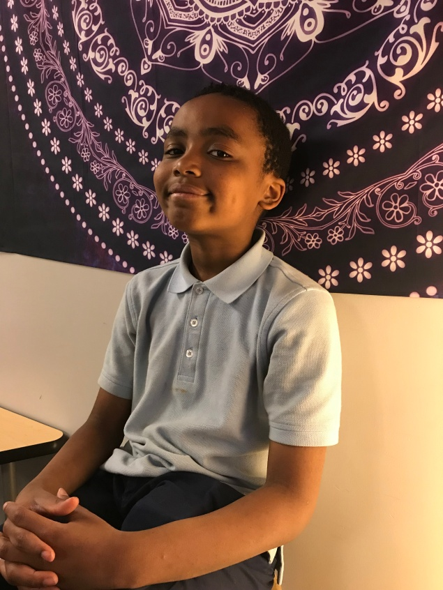 Semaj Crockett, 11, violin. Why do you like orchestra? Because it's fun, and I like learning how to play so I can teach other people [violin] when I grow up. How do you want to use music in your community? Or in the future? I don't know.Is there someone that you want to be like? No. Any musicians? No.